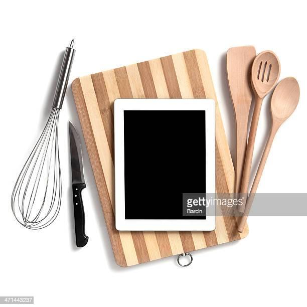 Küchenutensilien, die mit digitalen tablet