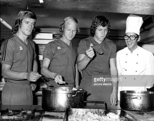 Dutch international football players Johnny Rep Rudd Geels and Arie Haan check out the kitchen at training camp near Hiltrup on July 26th The Dutch...