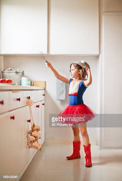 kitchen warrior - little girls up skirt fotografías e imágenes de stock