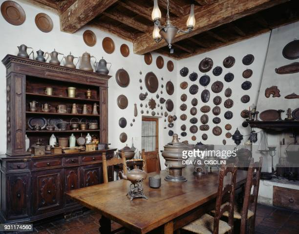 Kitchen with ancient wooden copper and pewter utensils on display Palazzo D'Arco Mantua Lombardy Italy 19th century