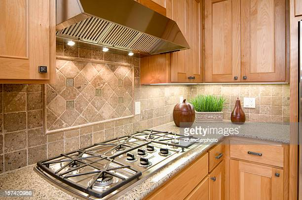 Kitchen with built in stove burner on counter