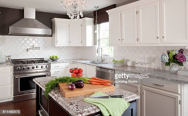 Kitchen with center island and fresh produce