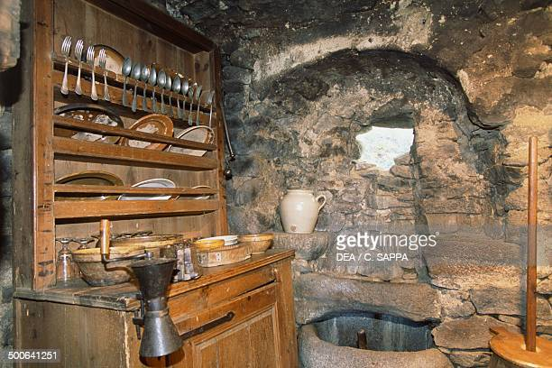 Kitchen with cupboard Farm Pierre Allegre Museum of rural life in 19th century RuynesenMargeride Auvergne France
