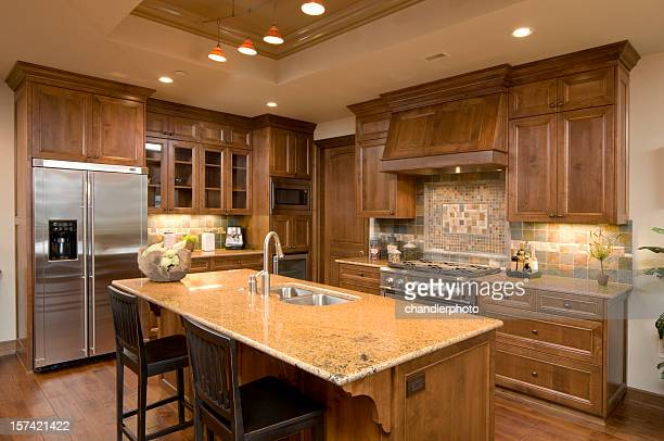 kitchen with granite island, and walnut cabinets - afzuigapparaat stockfoto's en -beelden