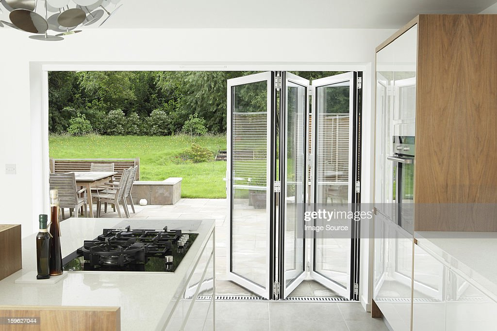 Kitchen with open patio doors : Stock Photo