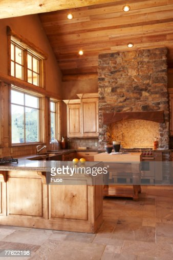 Kitchen With Stone Range Hood Stock Photo Getty Images