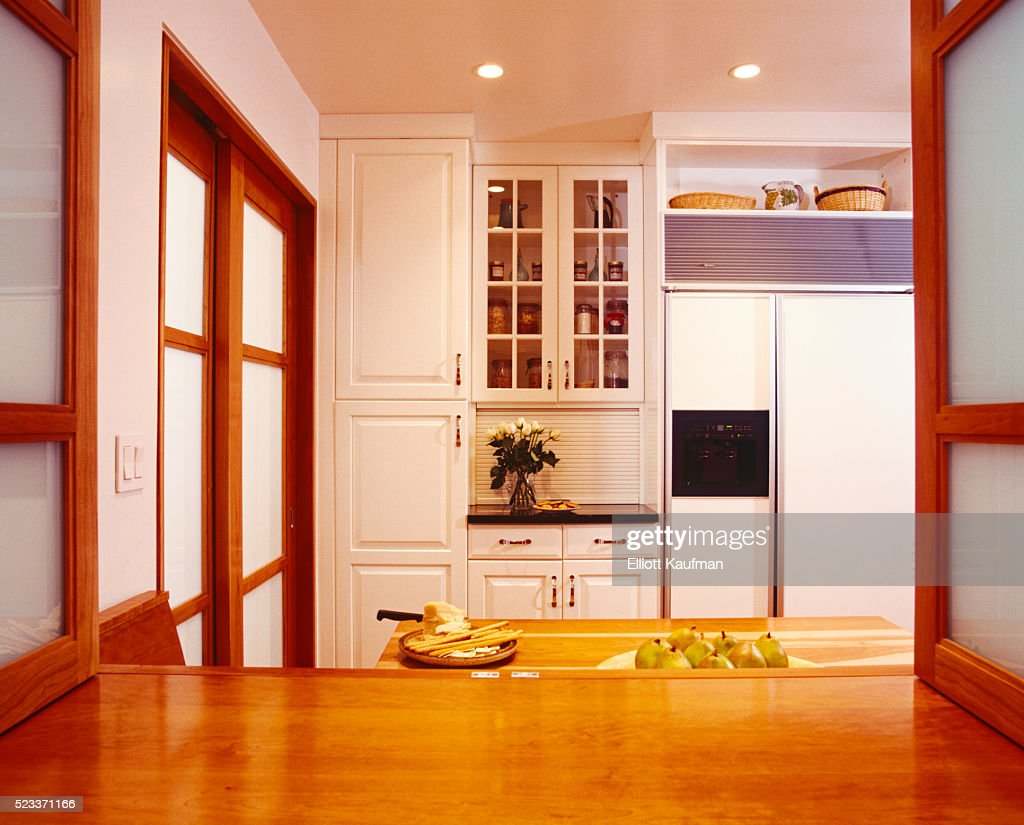 Kitchen With White Cabinetry And Wood Trim High Res Stock Photo Getty Images