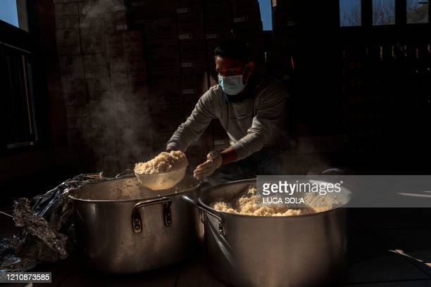 Kitchen worker prepares hot meals at Thava Indian restaurant, at The Gardens, for the daily food distribution in an informal settlement in Tembisa,...
