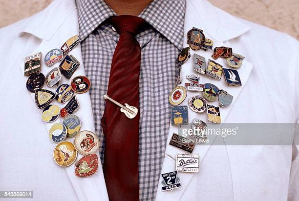 Kitchen worker sporting old Butlins badges on his lapels Butlin's issued badges a different design each year right up to 1967 Butlins Skegness is a...