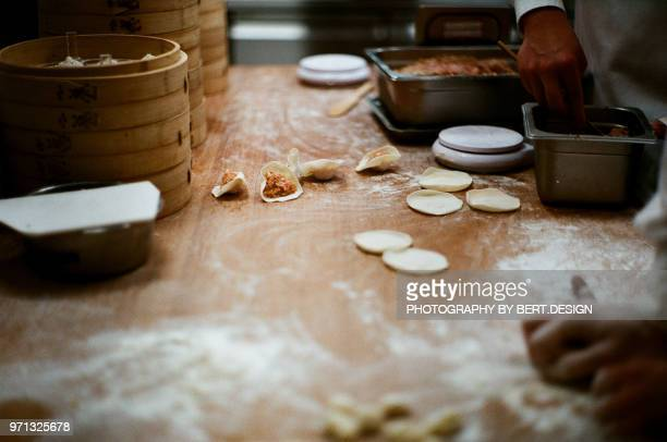 kitchener are making Xiaolongbao(Chinese dumpling) in back kitchen