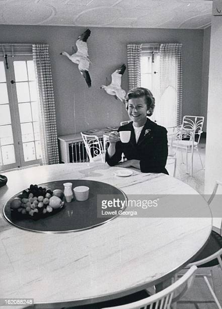 FEB 27 1961 MAR 5 1961 ***** Kitchens Tour Mrs Harry Combs sips coffee in her spacious kitchen which is being shown on the tour Two mounted snow...