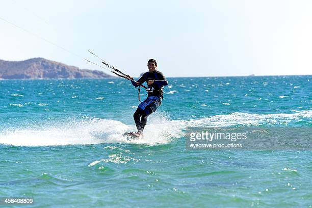kite boarder on ocean waves - eyecrave stock pictures, royalty-free photos & images