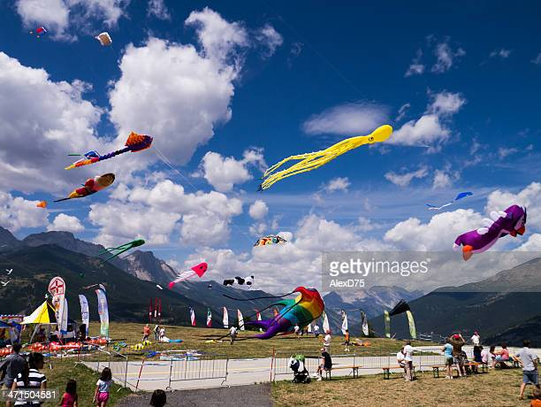 kite flying in a cloudy sky - kite toy stock photos and pictures
