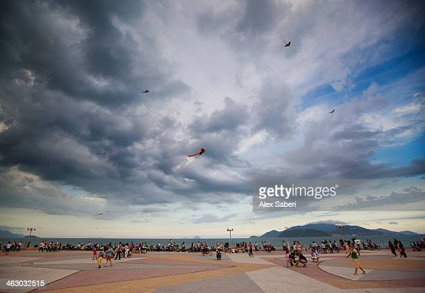kite flying on the walkway alongside nha trang beach. - alex saberi stock pictures, royalty-free photos & images