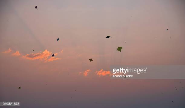 kite flying on uttarayan (makar sankranti), ahmedabad, gujarat, india - makar sankranti stock pictures, royalty-free photos & images