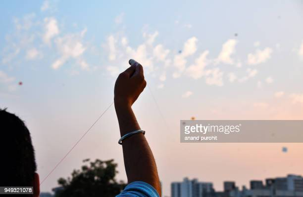 kite flying on uttrayan (makar sankranti), ahmedabad, gujarat, india - makar sankranti stock pictures, royalty-free photos & images