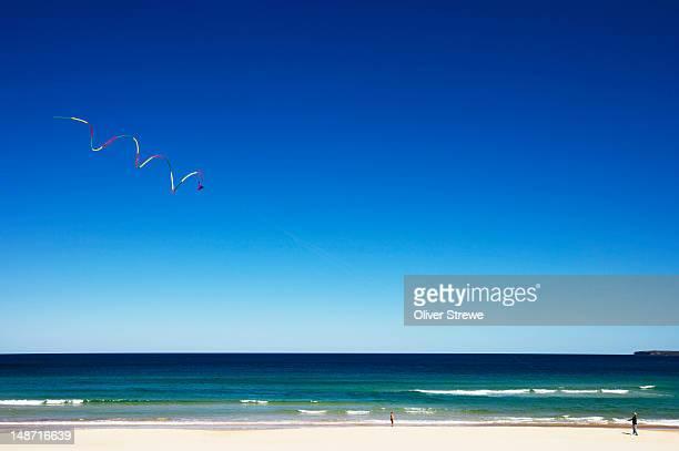 Kite flying over Bondi Beach.