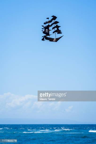 kite in the clear sky of bali - mauro tandoi stock photos and pictures