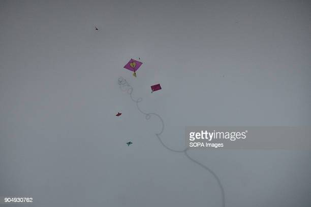 A kite is falling down from the sky in the day of Shakrain festival which held in southern part of the capital Dhaka BangladeshThe idea behind the...