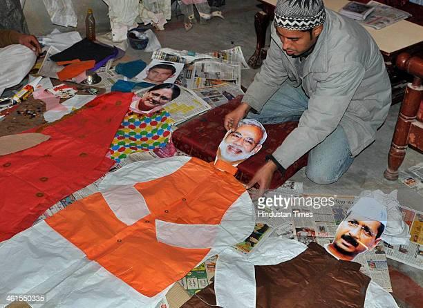 Kite maker prepares kites appearing BJPs PM candidate Narendra Modi, Delhi CM Arvind Kejriwal and Rajasthan CM Vasundhara Raje, as Makar Sankranti...