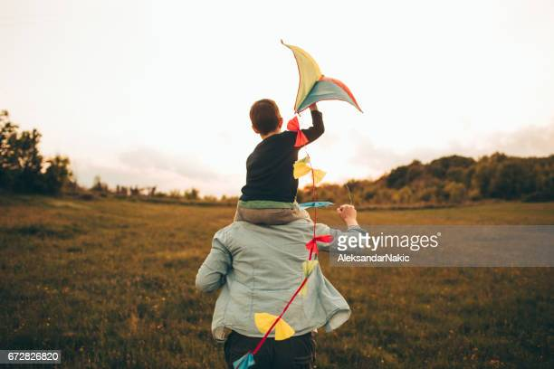 kite ready for fly off - happy family stock photos and pictures