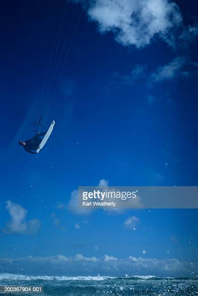 Kite surfer in mid-air, surface view