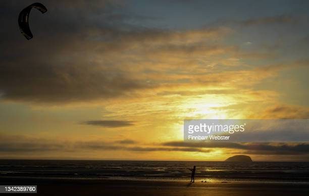 Kite surfer is seen at sunset on September 24, 2021 in Weston-super-Mare, United Kingdom.