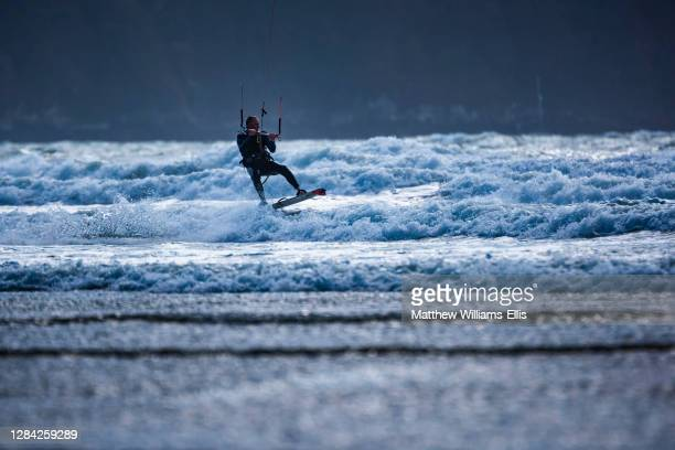 Kite surfer on Broadhaven Beach, Pembrokeshire Coast National Park, Wales, United Kingdom.