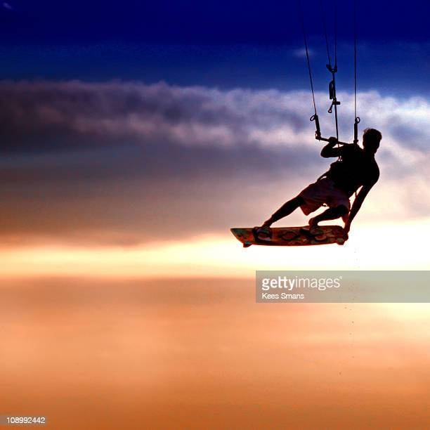 Kite surfer silhouetted sunset