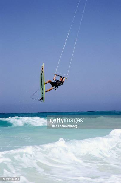 Kite Surfer Soaring Above Waves