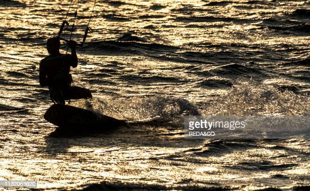 Kite surfers at golden sunset Dervio Como Lake Lombardy Italy Europe