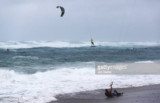 Kite surfers enjoy waves and wind from Tropical Storm Isaias as it passes through the area on August 02, 2020 in Juno Beach, Florida. The storm is...