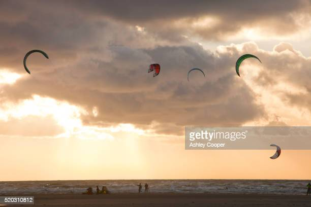 kite surfers on the fylde coast between blackpool and lytham, lancashire, uk. - blackpool stock pictures, royalty-free photos & images