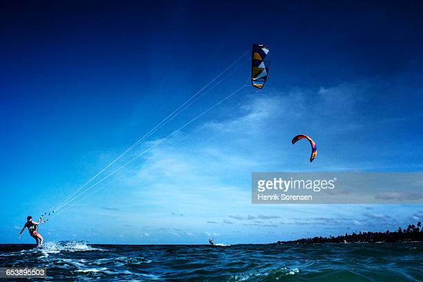 2 kite surfers - zanzibar island stock photos and pictures