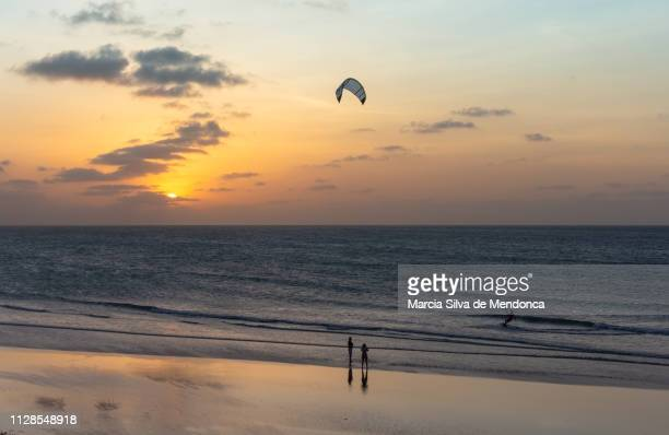 Kite surfing on the Jericoacoara beach, at the moment of the most beautiful sunset.