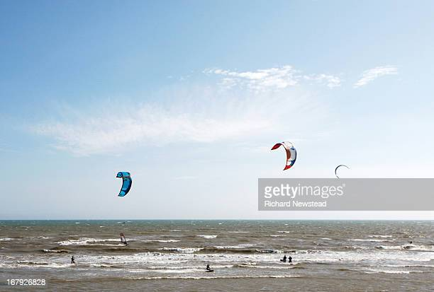 Kiteboarders or kitesurfers at Camber Sands. East Sussex, June 6th 2010