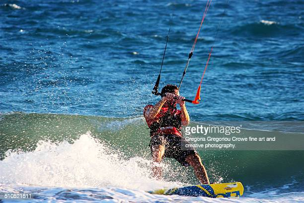 kiteboarding at curium beach, cyprus - gregoria gregoriou crowe fine art and creative photography. stockfoto's en -beelden