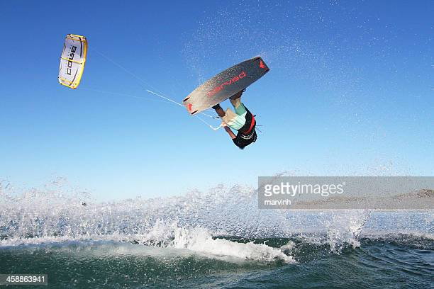 kiteboarding jump in western australia - kiteboarding stock photos and pictures