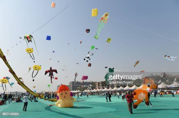 Kitefliers take part at the start of the International Kite Festival 2018 in the Indian city of Ahmedabad on January 7 2018 The festival ends on...