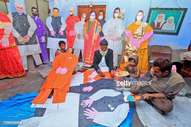 Kite-maker Abdul Gaffur Ansari makes life-size kites of politicians, ahead of the Makar Sakranti festival, at Handipura in Jaipur,Rajasthan,India,...