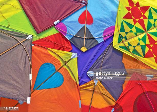 kites abstract colourful background - makar sankranti stock pictures, royalty-free photos & images