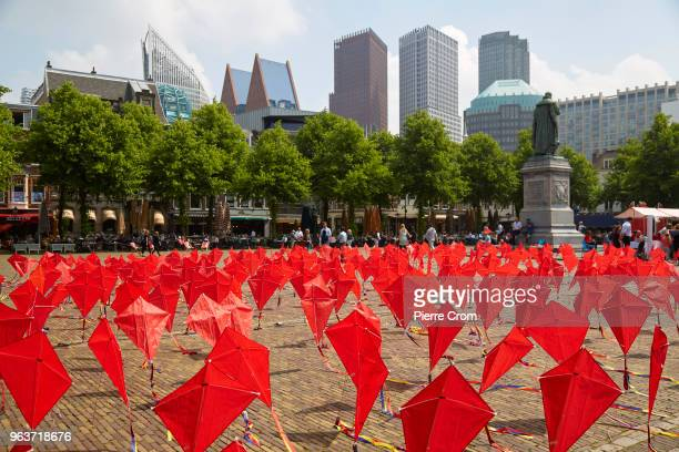 Kites are planted outside the parliament as human rights group Amnesty International hand over a petition signed by more the 68000 people to the...