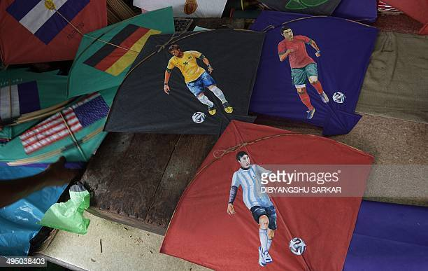 Kites bearing pictures of Portuguese soccer player Cristiano Ronaldo Brazilian soccer player Neymar and Argentine soccer player Lionel Messi are seen...