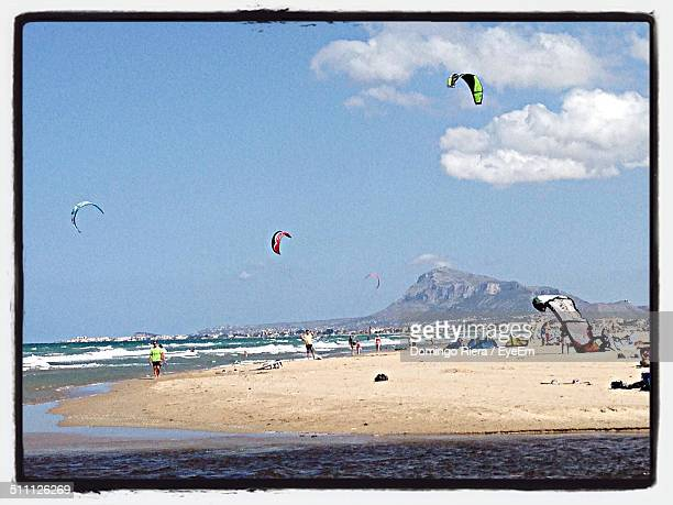 kites over beach - denia stock pictures, royalty-free photos & images