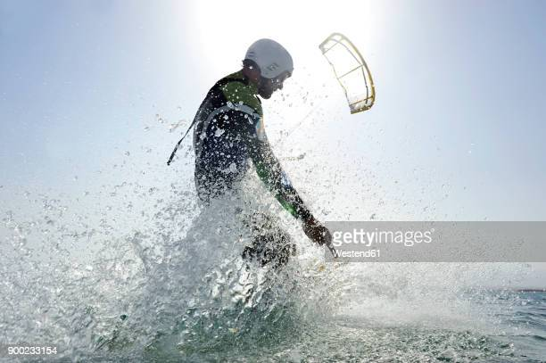 kitesurfer in the sea - water sport stock photos and pictures
