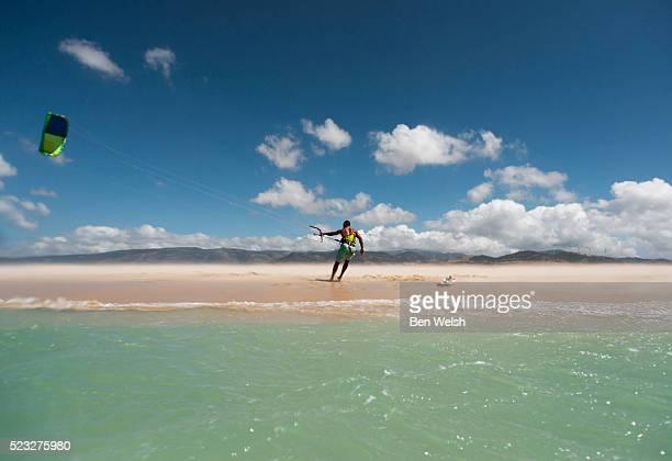 kitesurfer on lonely beach, costa de la luz, tarifa, spain - tarifa stock photos and pictures