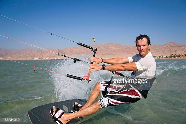 Kitesurfer pulls a face as he speeds past in Dahab's lagoon a favourite hotspot for many wind related watersports Sinai EGYPT