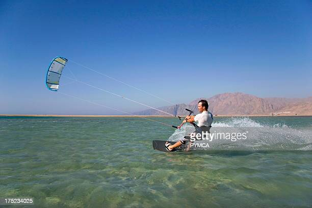 Kitesurfer speeds past in Dahab's lagoon a favourite hotspot for many wind related watersports Sinai EGYPT