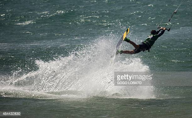 A kitesurfer takes part in an attemp of setting the World Record for the largest parade of kitesurfers at Los Lances beach near Tarifa on August 31...