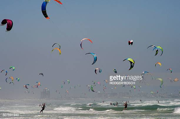 TOPSHOT Kitesurfers take part in the Kite surfing Armada in which participants are trying to break the Guinness World record for the 'largest parade...